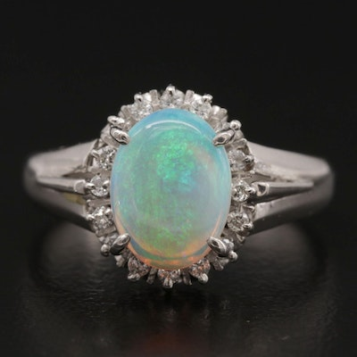 Platinum Opal Ring with Diamond Halo and Openwork Gallery
