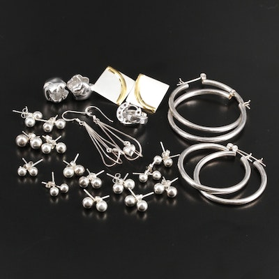 Sterling Silver Assortment of Earrings Featuring Hoops and Studs