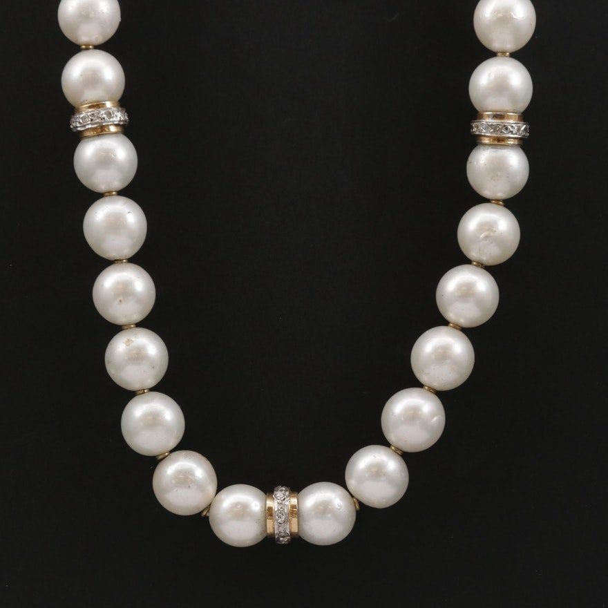 Strand of Pearls with 14K Diamond Spacer Beads and 18K Clasp