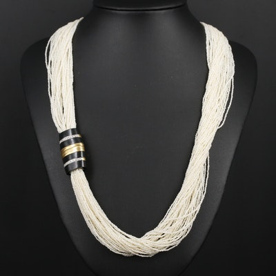 Seed Pearl Multi-Strand Necklace Featuring 18K Gold Diamond and Black Onyx Clasp