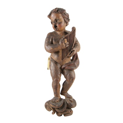 Carved and Polychromed Pine Putto with Harp, 18th Century