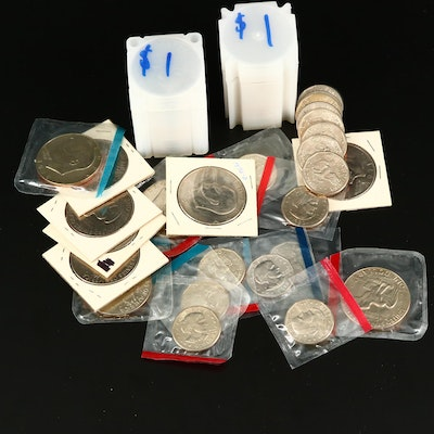Thirty-Two Eisenhower Dollars and Eighteen Susan B. Anthony Dollars