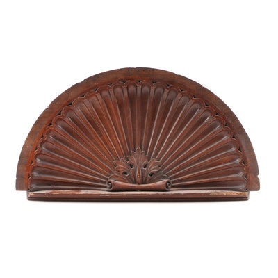 Stained Walnut Architectural Shell-form Over Door Panel