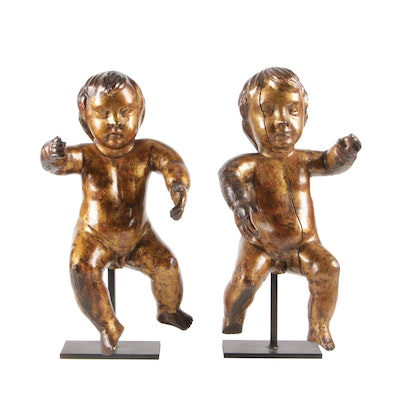 Pair of Giltwood Putti Figures on Metal Stands, 18th Century
