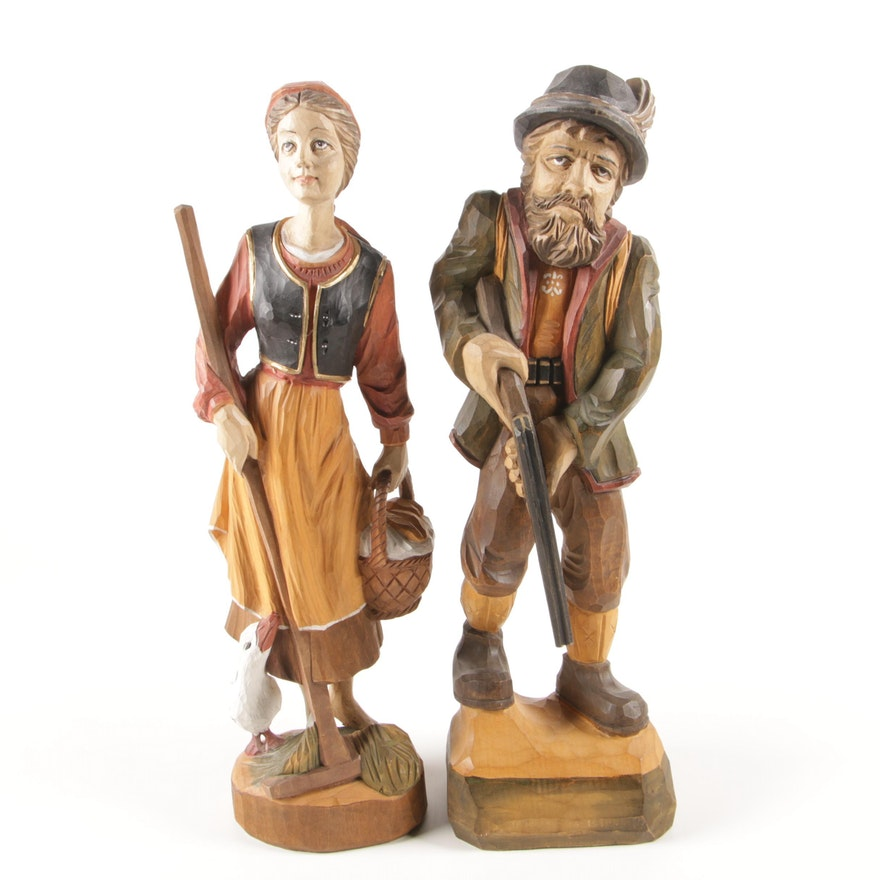Carved Wooden Figural Male Hunter and Woman with Tools