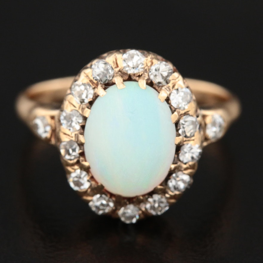 Vintage 14K Gold Opal and Diamond Halo Ring