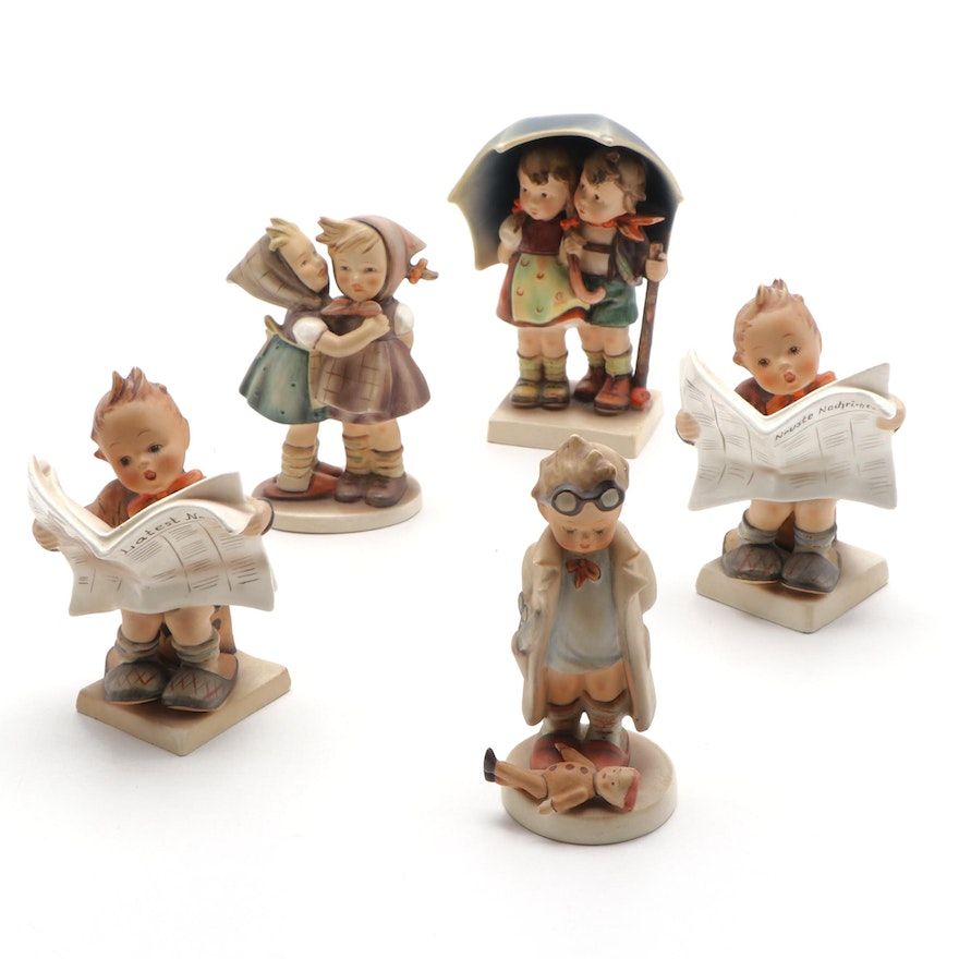"Hummel Figurines Including ""Stormy Weather"" and ""Latest News,"" 1950s"