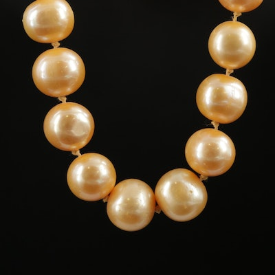 Strand of Orangey-Peach Semi-Baroque Pearls with 14K Fishhook Clasp