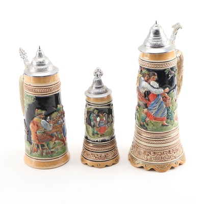 "German Steins, Includes Two ""Swiss Musical Movement"" Steins"