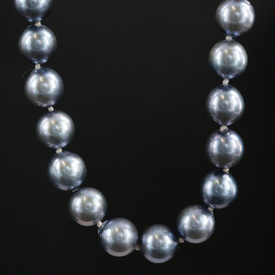 Single Strand of Medium Dark Violet Pearls with 14K Closure