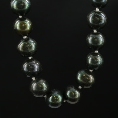 Strand of Dark Green Pearls with 14K Clasp