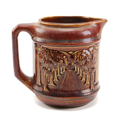 Rockingham Style Earthenware Brown Forest Motif Pitcher,