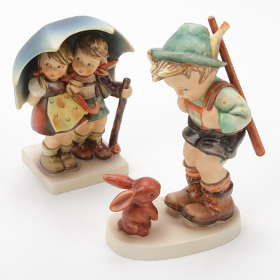 "Goebel ""Sensitive Hunter"" and ""Stormy Weather"" Porcelain Hummel Figurines"