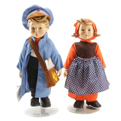 Hummel Postman and Schoolgirl Dolls on Stands, Late 20th Century