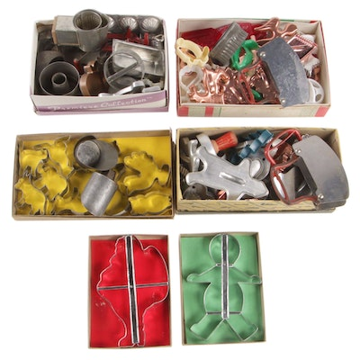 Bent Metal and Plastic Cookie Cutters with Other Bakeware