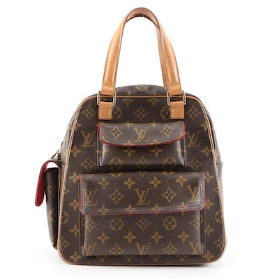 Louis Vuitton Excentri-Cite Handbag in Monogram Canvas and Vachetta Leather