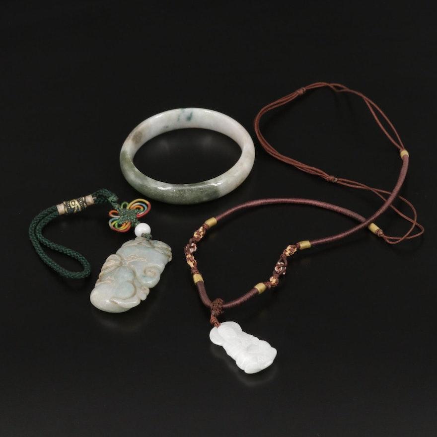 Carved Jadeite Bangle and Pendants