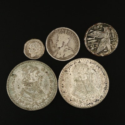 Collection of Foreign Silver Coins and Egyptian Themed Token
