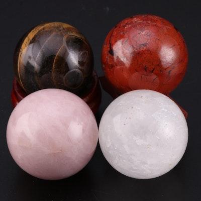 Polished Tigers Eye, Rose Quartz and Other Spherical Mineral Specimens