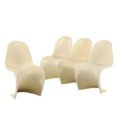 Four Modernist Molded Plastic Cantilever Side Chairs