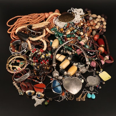 Assortment of Jewelry Including Wood Beaded Necklaces and Carved Heart Necklace