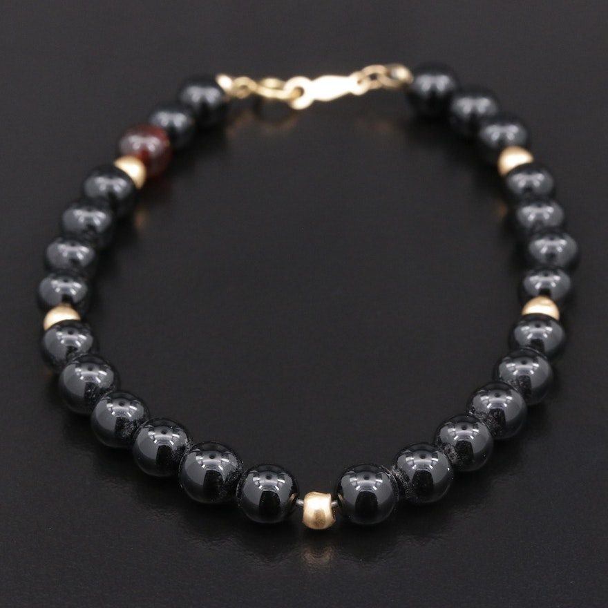 Black Onyx Bracelet with 14K Yellow Gold Accents