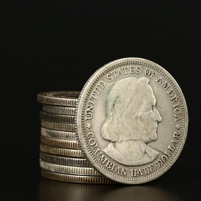 Eleven 1893 Columbian Exposition Commemorative Silver Half Dollars