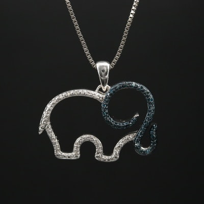Sterling Silver Diamond Elephant Pendant Necklace Featuring Blue Diamonds