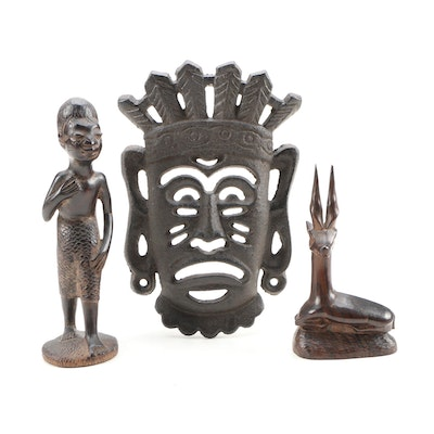 Tanzanian Carved Ebony Figures and Metal Mask, 20th Century