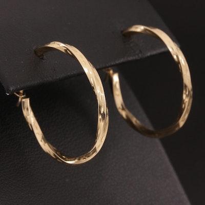 10K Hoop Earrings Featuring Twisting Motif
