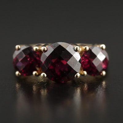 10K Garnet Three Stone Ring