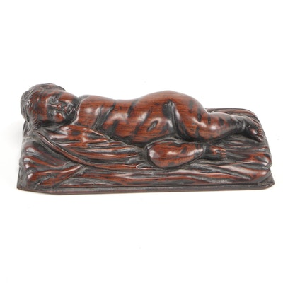 Continental Carved Rosewood Figure of an Infant, Late 18th or Early 19th Century