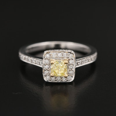 18K Fancy Intense Yellow Diamond and Diamond Halo Ring