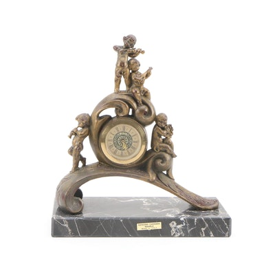 Baroque Style Mantle Clock with Resin Putti Figurals and Carrara Marble Base