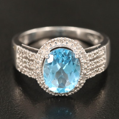 Sterling Silver Blue Topaz Ring with Diamond Shoulders and Halo