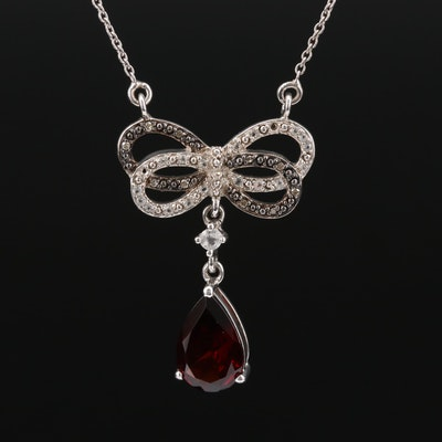 Sterling Silver Garnet, Diamond, and White Spinel Ribbon Pendant Necklace