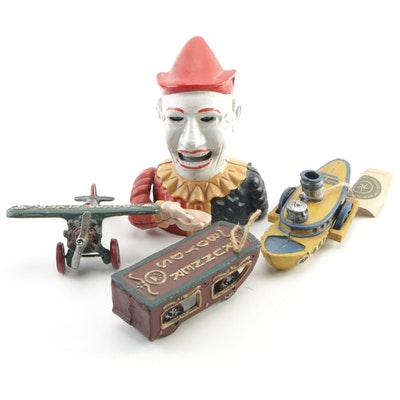 Boyds Cast Iron Wheeled Toys and Cast Iron Mechanical Clown Bank