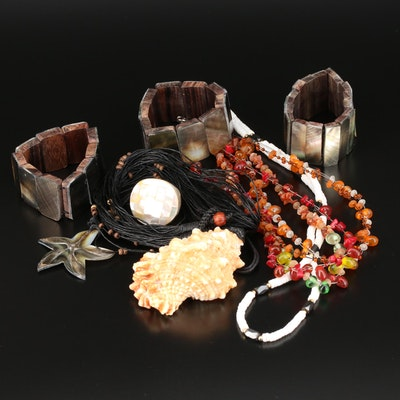 Assorted Jewelry Featuring Shell, Mother of Pearl, and Amber