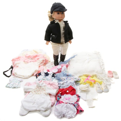 Götz Doll with Assorted Clothing