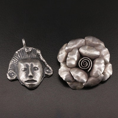 Aztec Style Figural Pendant and Fine Silver Floral Pendant