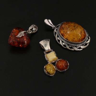 Sterling Amber Pendants Including Heart Motif