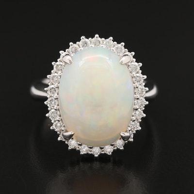 Platinum 6.21 CT Opal and Diamond Halo Ring