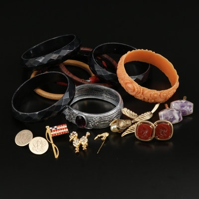 Vintage Jewelry Selection Featuring Bangle Bracelets, Cufflinks, and Brooches