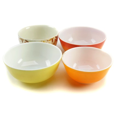 """Pyrex Flameglo, Yellow, and Orange Mixing Bowls with Hall """"Autumn Leaf"""" Bowl"""