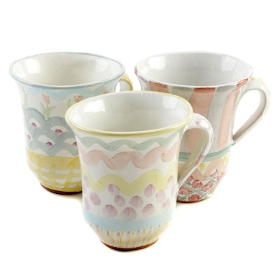 "MacKenzie-Childs Ceramic Mugs Including ""King Ferry"" and ""Rose Cottage"""