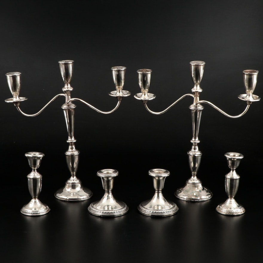 Empire Convertible Weighted Sterling Candelabra with Other Sterling Candlesticks