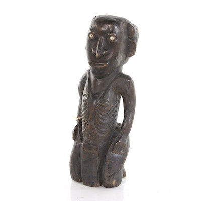 Dayak Wood Carved Kneeling Figure with Shell In Lay Eyes, 20th Century