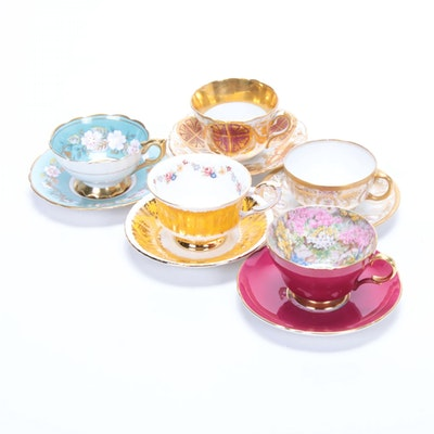 Shelley, Royal Stafford, Paragon, and Other Gilt Porcelain Teacups and Saucers