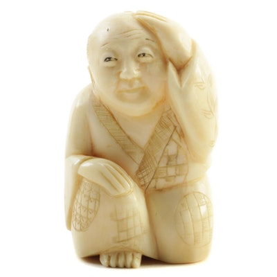 Japanese Carved Bone Kneeling Man Netsuke