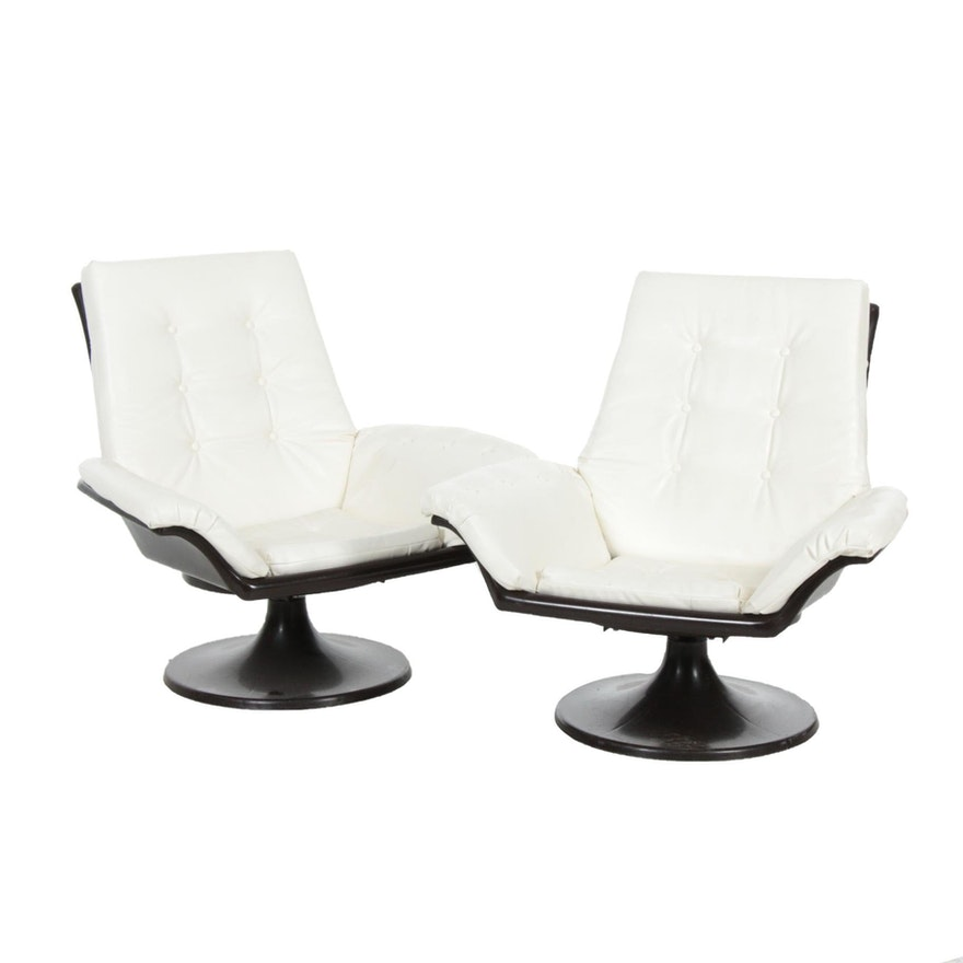 Pair of Decorion Fun Furnishings White Naugahyde Swivel Chairs, Late 20th C.